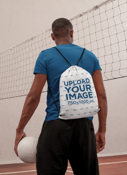 Drawstring Bag Mockup Featuring a Man Ready to Play Volleyball