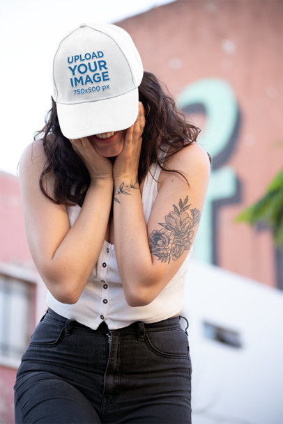 Dad Hat Mockup Featuring a Smiling Woman Hiding Her Eyes 27036