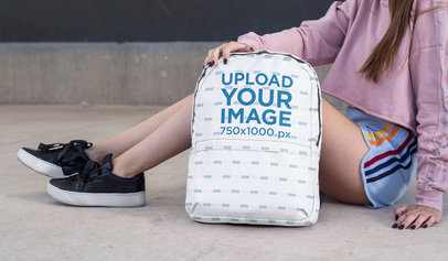 Backpack Mockup Featuring a Teen Sitting on a Street 27718