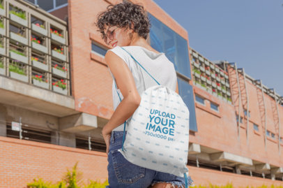 Drawstring Bag Mockup of a Woman on Her Way to School 27575