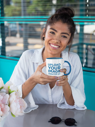 Mockup Featuring a Smiling Woman in a Coffee Shop Holding a Two-Toned 11 oz Coffee Mug 27829