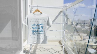 Video of a T-Shirt Hanging at a Sunny Balcony 13861