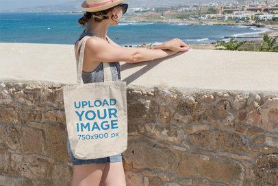 Tote Bag Mockup Featuring a Woman Looking at the Ocean 9-el