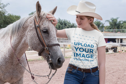 T-Shirt Mockup Featuring a Country Girl Petting a Horse 27969