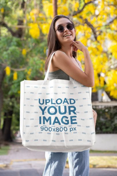 Grocery Bag Mockup Featuring a Woman with Sunglasses in Front of a Flowering Tree 27630
