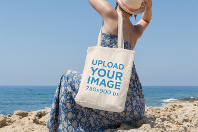 Tote Bag Mockup Featuring a Woman Facing Backward at the Beach 15-el