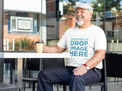 Elderly Man at a Cafe Enjoying a Coffee T-Shirt Mockup a8536