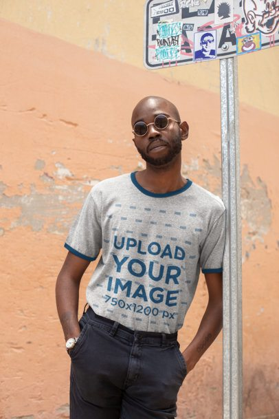 Ringer T-Shirt Mockup of a Man Leaning Against a Street Sign Post 27919