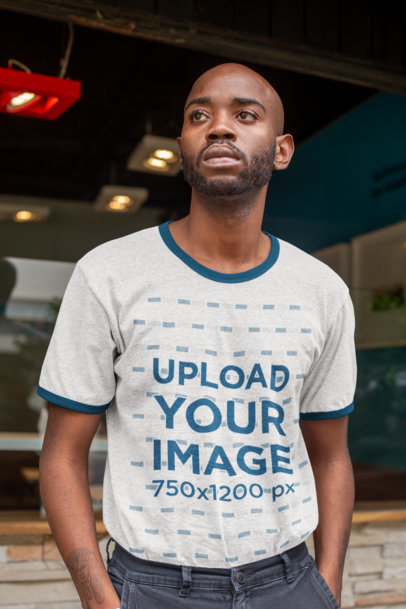 Ringer T-Shirt Mockup Featuring a Serious-Looking Young Man 27907