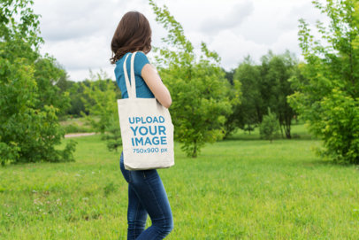 Tote Bag Mockup of a Woman at a Grove 20-el
