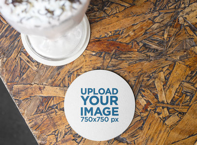 Mockup of a Round Coaster on a Wooden Surface near a Milkshake 27798
