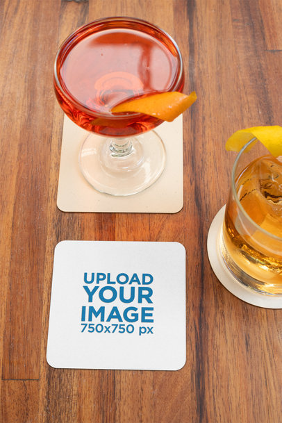 Squared Coaster Mockup Placed over a Wooden Surface by Some Cocktails 27791