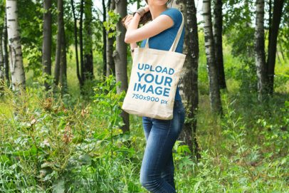 Tote Bag Mockup Featuring a Woman Walking in the Woods 22-el