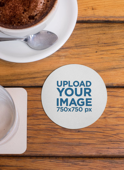 Mockup of a Round Coaster Placed Next to a Cup of Hot Chocolate 27805