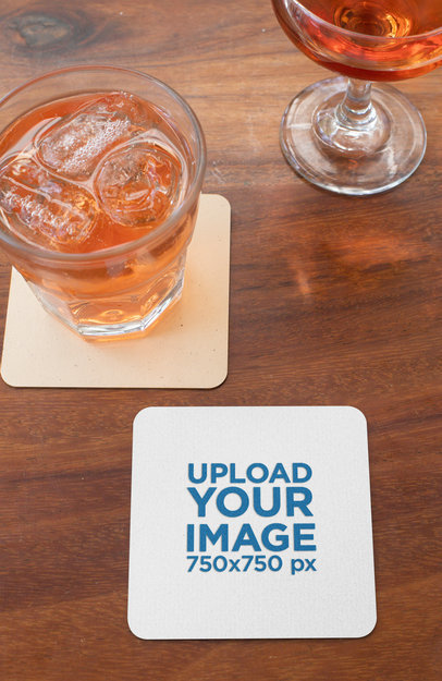 Square Coaster Mockup Featuring Two Beverages on a Wooden Table 27796