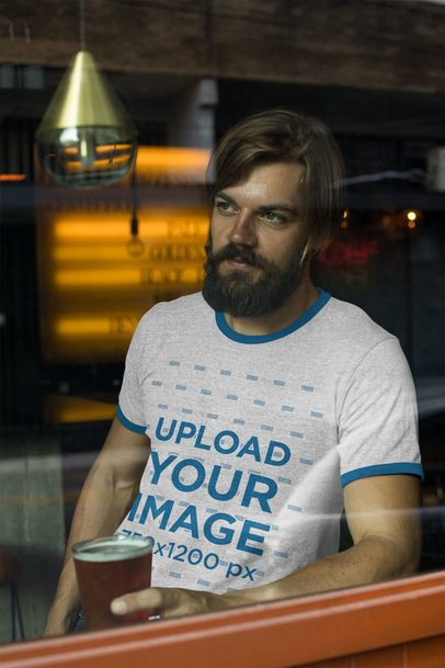 Ringer Tee Mockup Featuring a Bearded Man Holding a Glass Behind a Window 27929