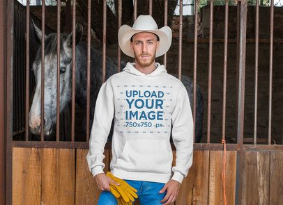Hoodie Mockup Featuring a Cowboy Standing Next to a Horse 27959