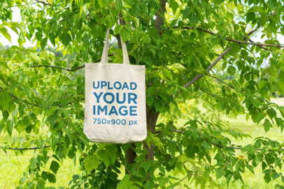 Mockup of a Tote Bag Hanging from a Tree 26-el
