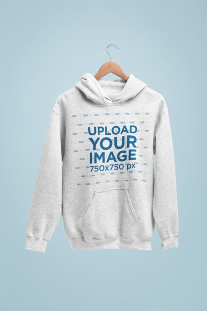 Mockup of a Hoodie in a Hanger Against a Solid Background 27735