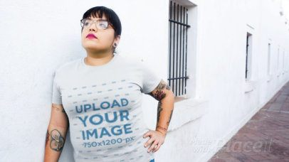 T-Shirt Video of a Tattooed Woman Posing Outside a White Building 12645