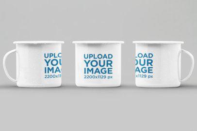 Mockup of Three 12 oz Enamel Mugs Against a Flat Surface 27879