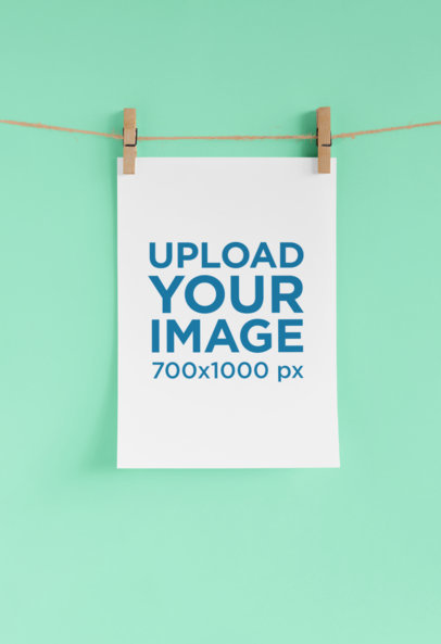 Mockup of an A4 Letterhead Hung on Two Clothespins 27227