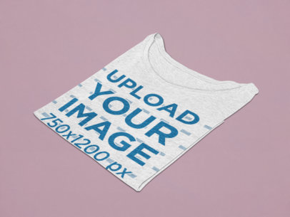 Mockup of a Folded Heathered T-Shirt Over a Flat Surface 27673