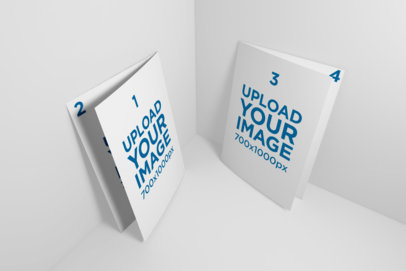 Mockup of Two Bi-Fold A5 Brochure Standing in a Color-Customizable Corner 33-el