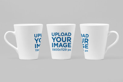 Mockup of Three 11 oz Mugs In Different Angles Against a Solid Surface 27886