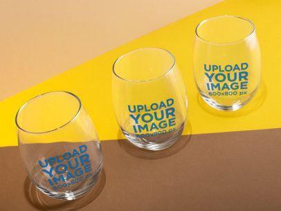 Mockup of Three Stemless Wine Glasses with a Colorful Background 27945