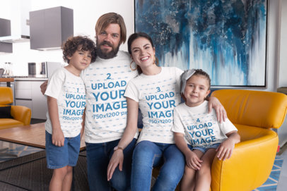 Mockup of a Family of Four Wearing T-Shirts in the Living Room 28060