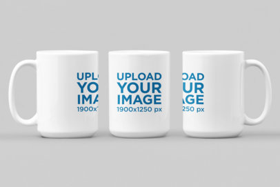 Mockup of Three Different-Angled 15 oz Mugs Against a Flat Environment 27882