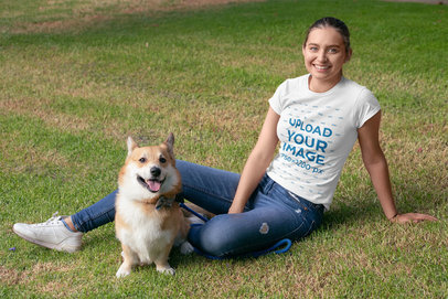 T-Shirt Mockup Featuring a Woman Lying on the Grass Next to Her Puppy