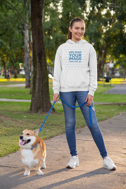 Pullover Hoodie Mockup of a Woman Walking Her Dog at the Park