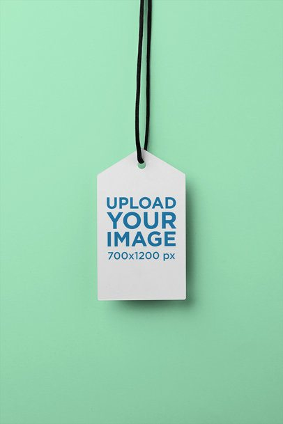 Brand Tag Mockup Hanging Against a Flat Background 27650