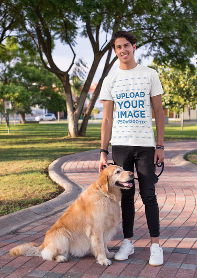 Shirt Mockup of a Man Taking a Walk with His Dog at a Park