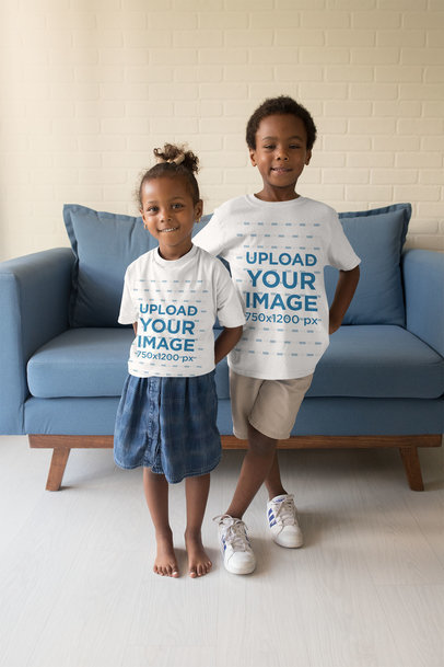 T-Shirt Mockup of Two Little Kids Posing in the Living Room 28070