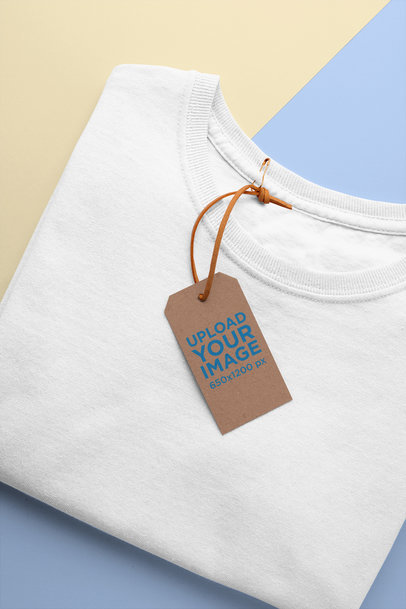 Mockup of a Clothing Tag Attached to a Folded T-Shirt 27641