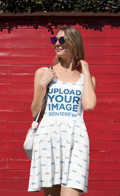 Mockup of a Cool Woman Under the Sun Wearing a Dress 27990