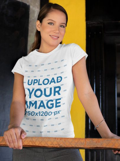 T-Shirt Mockup of a Woman Leaning on a Handrail 28207