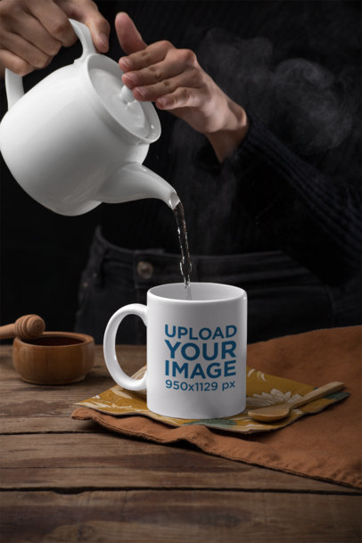 Mockup of a Woman Pouring Hot Water in an 11 oz Mug 28172