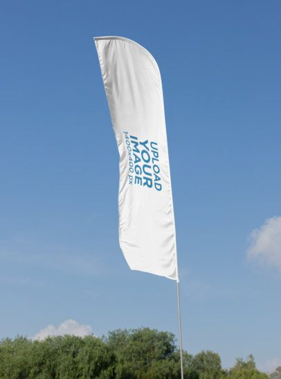 Mockup of a Flag Banner at a Park 28029