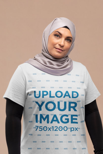T-Shirt Mockup of a Woman with a Hijab at a Studio 28278