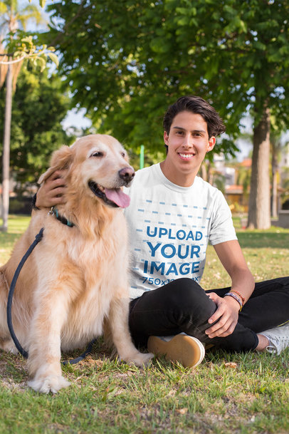 T-Shirt Mockup of a Man Sitting Next to His Dog at a Park 28050