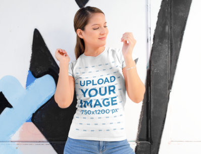 Shirt Mockup of a Woman Posing Against a Street Art Mural 28202