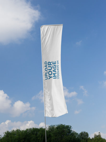 Flag Banner Mockup Against a Blue Sky Backdrop 28034
