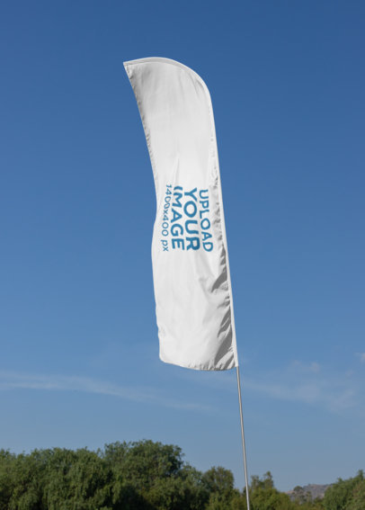 Mockup of a Flag Banner Against a Clear Sky 28033