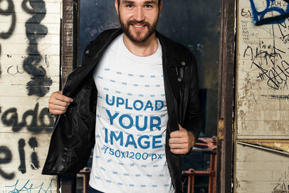 T-Shirt Mockup of a Man With a Leather Jacket Against a Graffiti Wall 28193