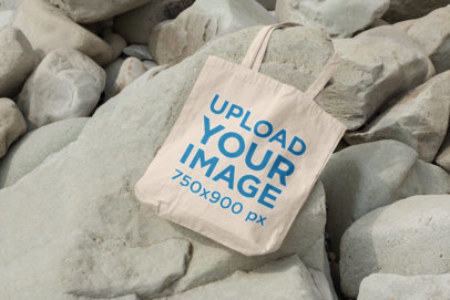 Mockup Featuring a Tote Bag Surrounded by Rocks 107-el