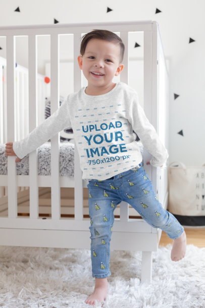 Long Sleeve Shirt Mockup of a Kid Standing Next to a Baby Cradle 28085